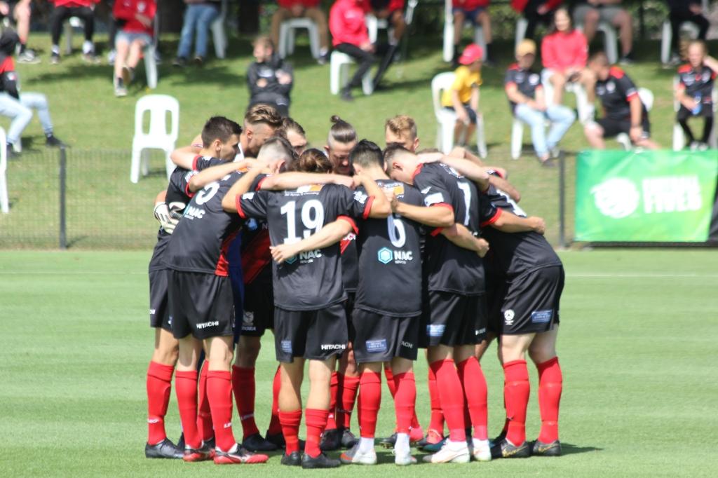 Edgeworth Eagles team huddle before kick-off